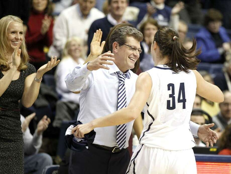 Jan 21, 2013; Storrs, CT, USA; Connecticut Huskies head coach Geno Auriemma hugs guard Kelly Faris (34) as she comes off the court against the Duke Blue Devils during the second half at Gampel Pavilion. UConn defeated Duke 79-49. Mandatory Credit: David Butler II-USA TODAY Sports Photo: David Butler II-USA TODAY Sports / David Butler II