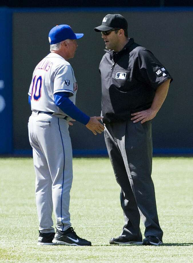 ASSOCIATED PRESS New York Mets coach Terry Collins, left, argues a call with second base umpire Brian Knight during the ninth inning of an interleague baseball game in Toronto on Saturday. The Blue Jays beat the Mets 2-0.