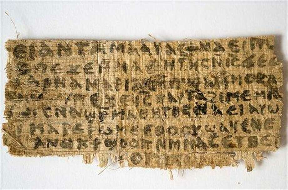 """This Sept. 5, 2012 photo released by Harvard University shows a fourth century fragment of papyrus that divinity professor Karen L. King says is the only existing ancient text that quotes Jesus explicitly referring to having a wife.  King, an expert in the history of Christianity, says the text contains a dialogue in which Jesus refers to """"my wife,"""" whom he identified as Mary. King says the fragment of Coptic script is a copy of a gospel, probably written in Greek in the second century. (AP Photo/Harvard University, Karen L. King) Photo: AP / Harvard University"""