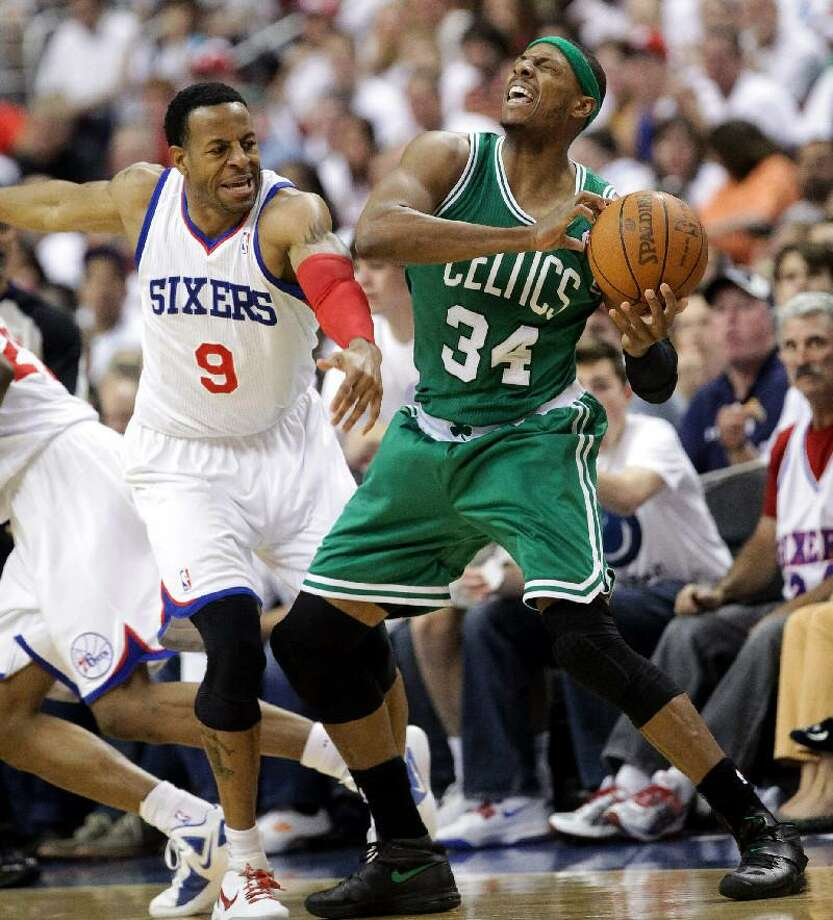 ASSOCIATED PRESS 76ers forward Andre Iguodala smacks across the face of Celtics forward Paul Pierce during Game 3 of their Eastern Conference semifinal series. The teams meet in Game 5 on Monday in Boston.