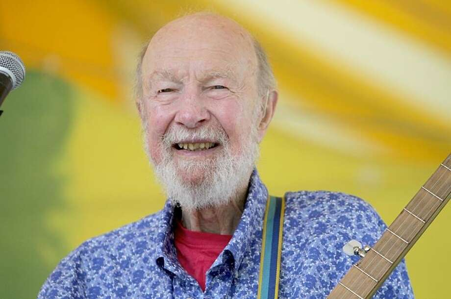 """Folk singer and an iconic figure in the mid-twentieth century Pete Seeger is shown performing on stage during a """"live"""" concert appearance. Photo: Photo By John Atashian / John Atashian"""