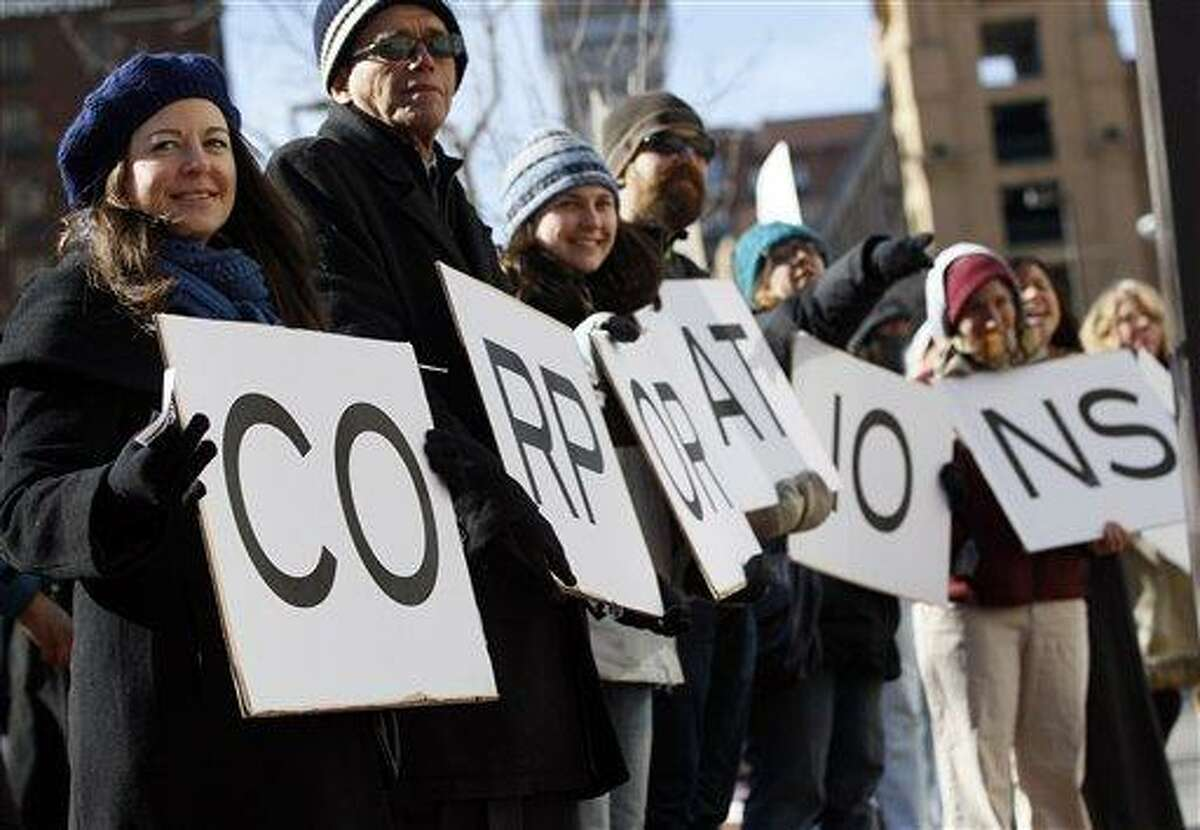 People protest against spending in federal elections in front of the U.S. District Courthouse in Baltimore, Friday, Jan. 20, 2012. Anti-Wall Street demonstrators across the U.S. planned rallies Friday in front of banks and courthouses. (AP Photo/Patrick Semansky)
