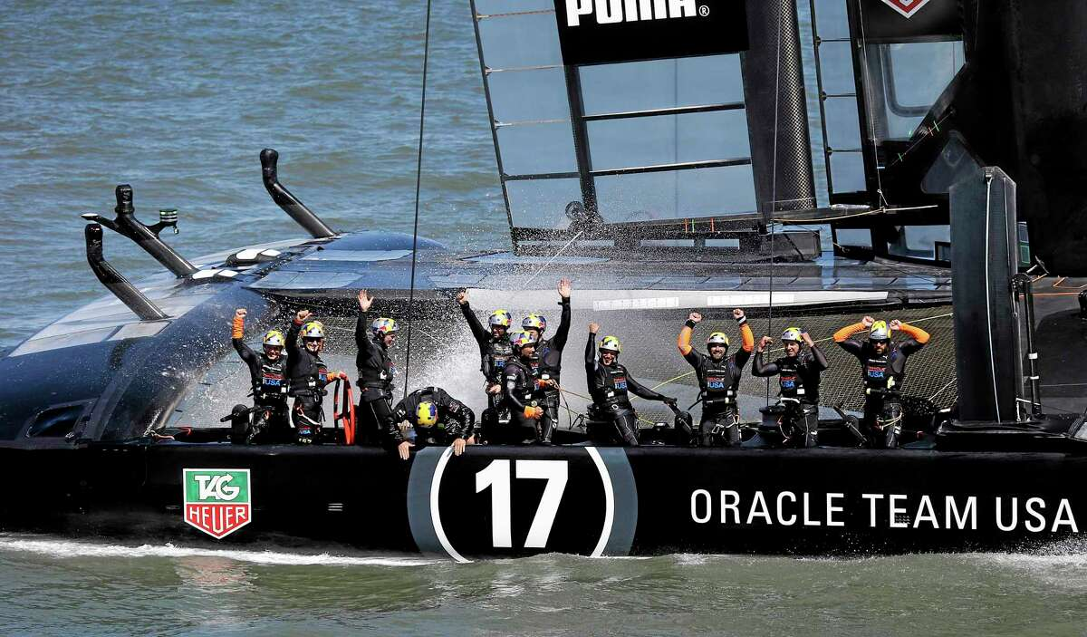 Oracle Team USA crew celebrates after winning the 19th race against Emirates Team New Zealand to win the America's Cup sailing event Wednesday, Sept. 25, 2013, in San Francisco. (AP Photo/Marcio Sanchez)