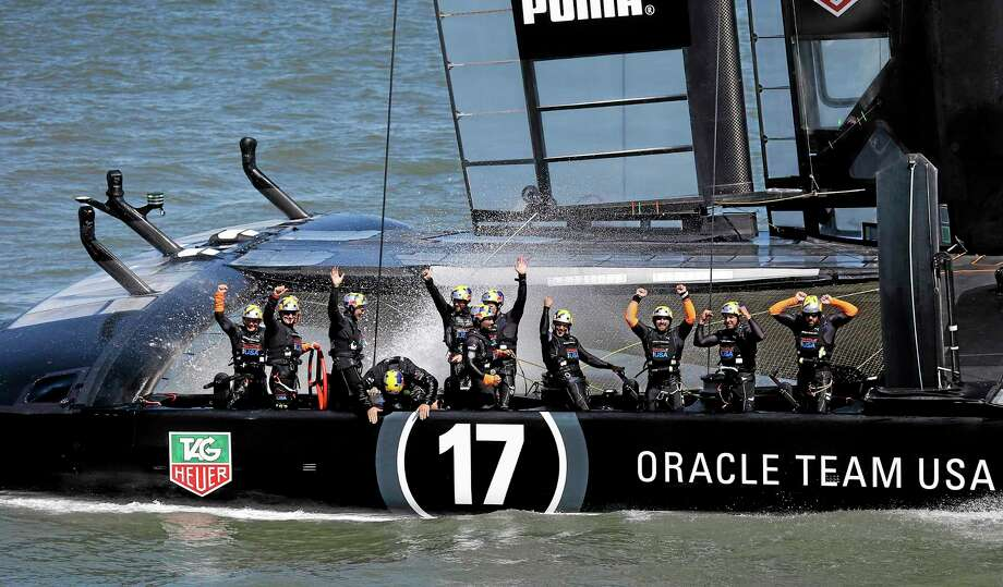Oracle Team USA crew celebrates after winning the 19th race against Emirates Team New Zealand to win the America's Cup sailing event Wednesday, Sept. 25, 2013, in San Francisco. (AP Photo/Marcio Sanchez) Photo: AP / AP