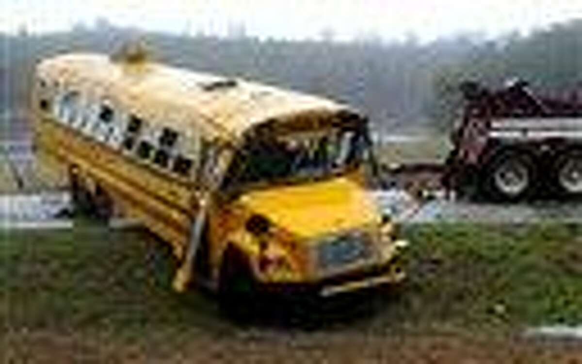 A school bus is uprighted following a wreck on Pike County Road 2243 in Goshen, Ala., Friday. More than 20 students were sent to Troy and Luverne hospitals after the bus overturned in Goshen. Associated Press