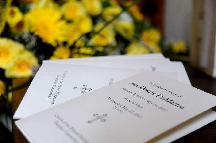 DeMatteo's funeral programs. Darren Yip/Register