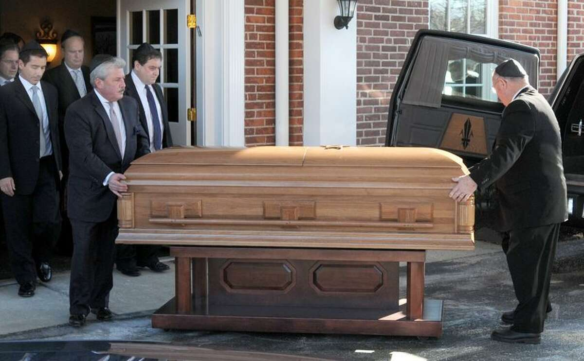 After funeral services, Dr. Mel Goldstein's casket leaves the Robert E. Shure Funeral Home in New Haven for interment. Photo by Peter Hvizdak / New Haven Register