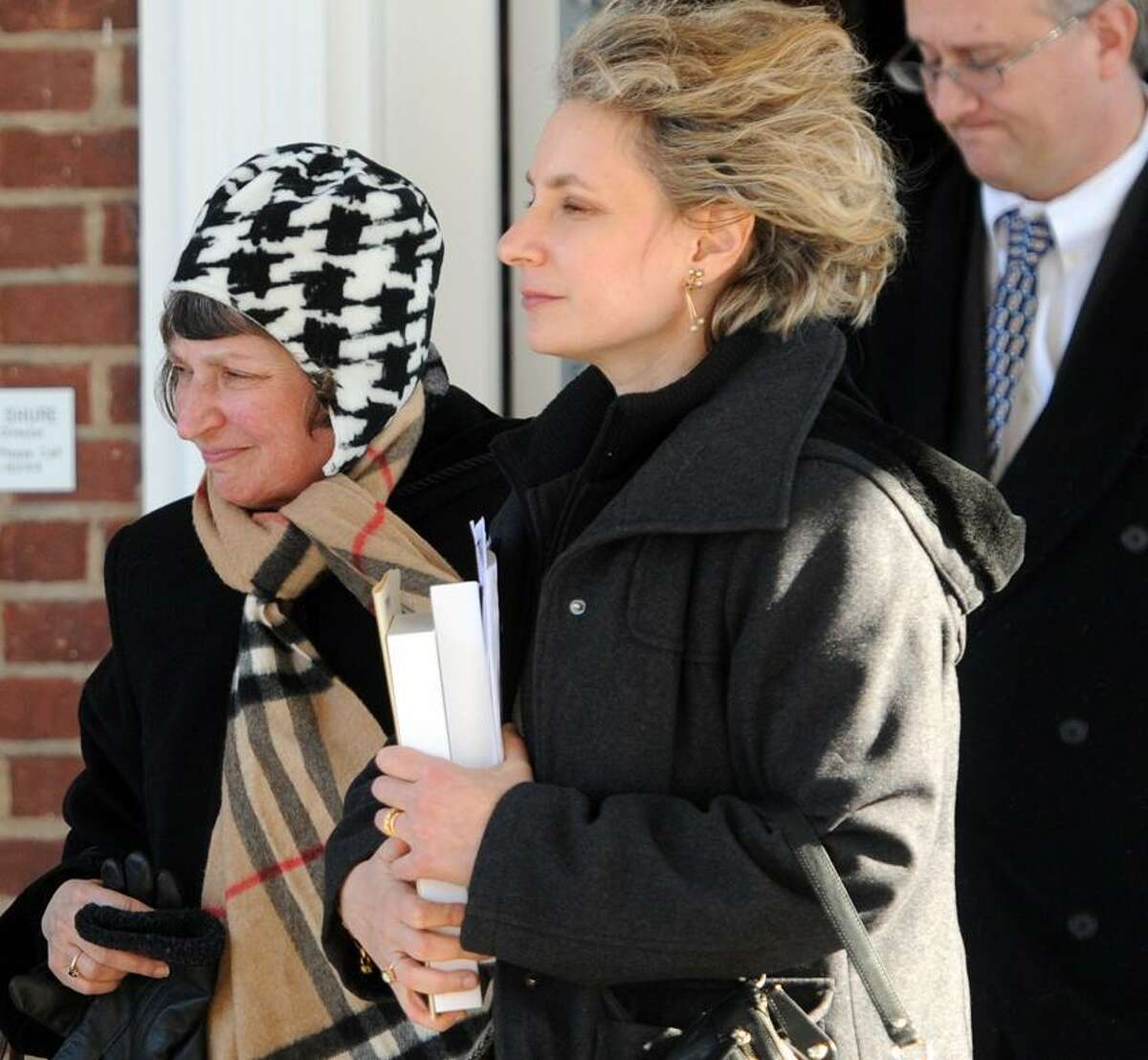 After funeral services, Dr. Mel Goldstein's wife Arlene Goldstein, left, and her daughter Laura Goldstein, center, leave the Robert E. Shure Funeral Home in New Haven for Dr.Mel's interment. Photo by Peter Hvizdak / New Haven Register