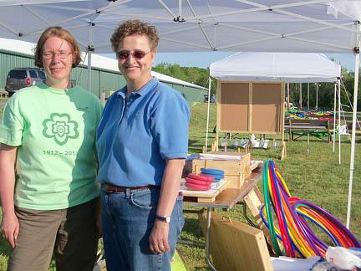 Jonetta Badillo I The Middletown Press Linda Kalish, right, director of program, and Janet Ridenour, senior director of program services, are at the Durham Fairgrounds Friday preparing for the Girl Scout Jubilee that will take place Saturday in honor of the Girl Scouts' 100th anniversary. Watch the video at middletownpress.com.