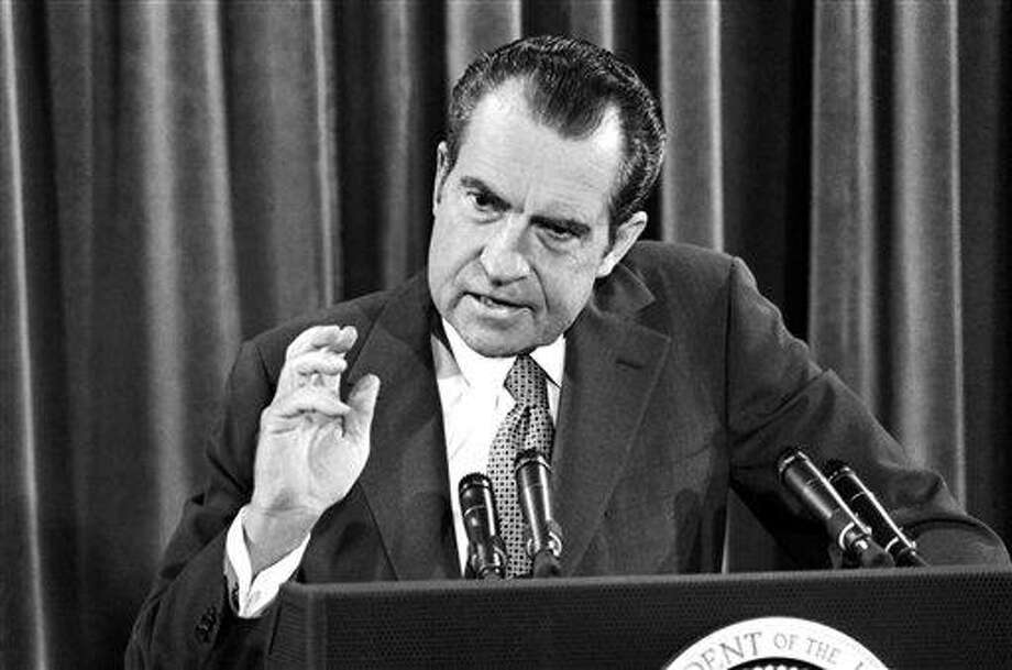 President Richard Nixon gestures during his news conference in Washington, June 29, 1972. Nixon announced the United States will return to the Paris peace talks without pre-conditions but with hopes for serious negotiations. (AP Photo) Photo: AP / AP