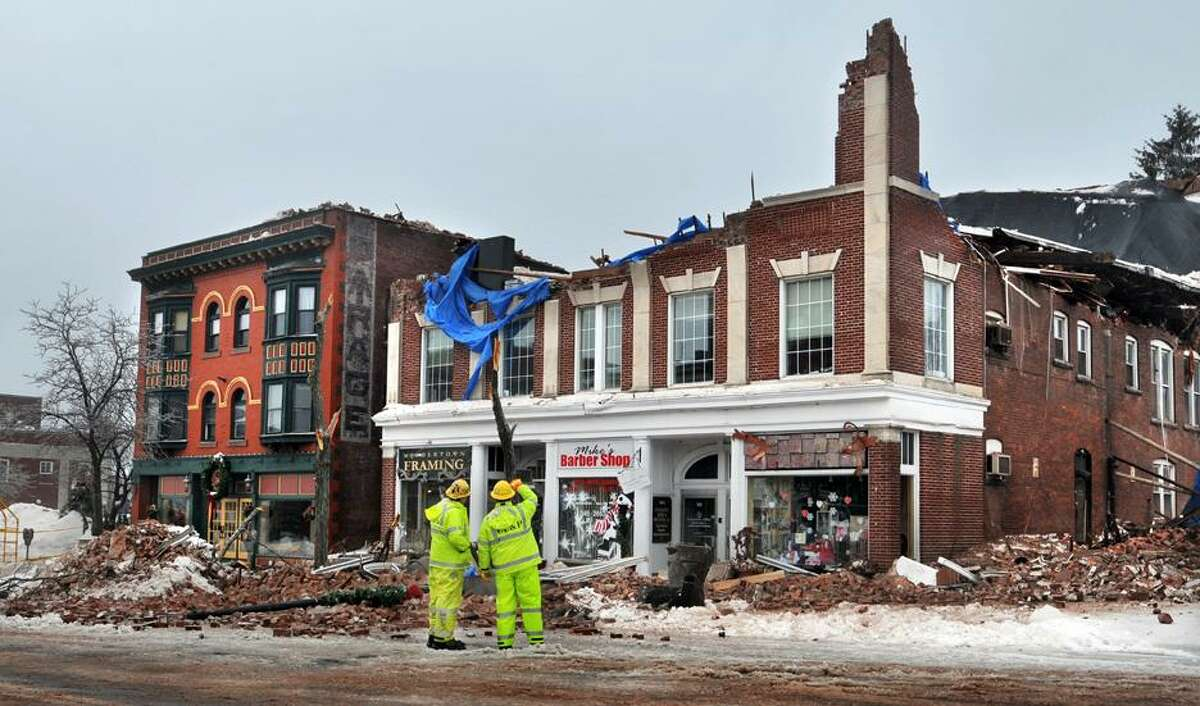 @CAvaloneMP 9.19.12 Mike DiPiro and Mike Sokolowski, of Guilmartin, DiPiro and Sokolowski stand at the entrance to 505 Main Street in Middletown Wednesday afternoon, only eighteen months after the former building collapsed under the weight of heavy, wet snow that piled up on the roof.
