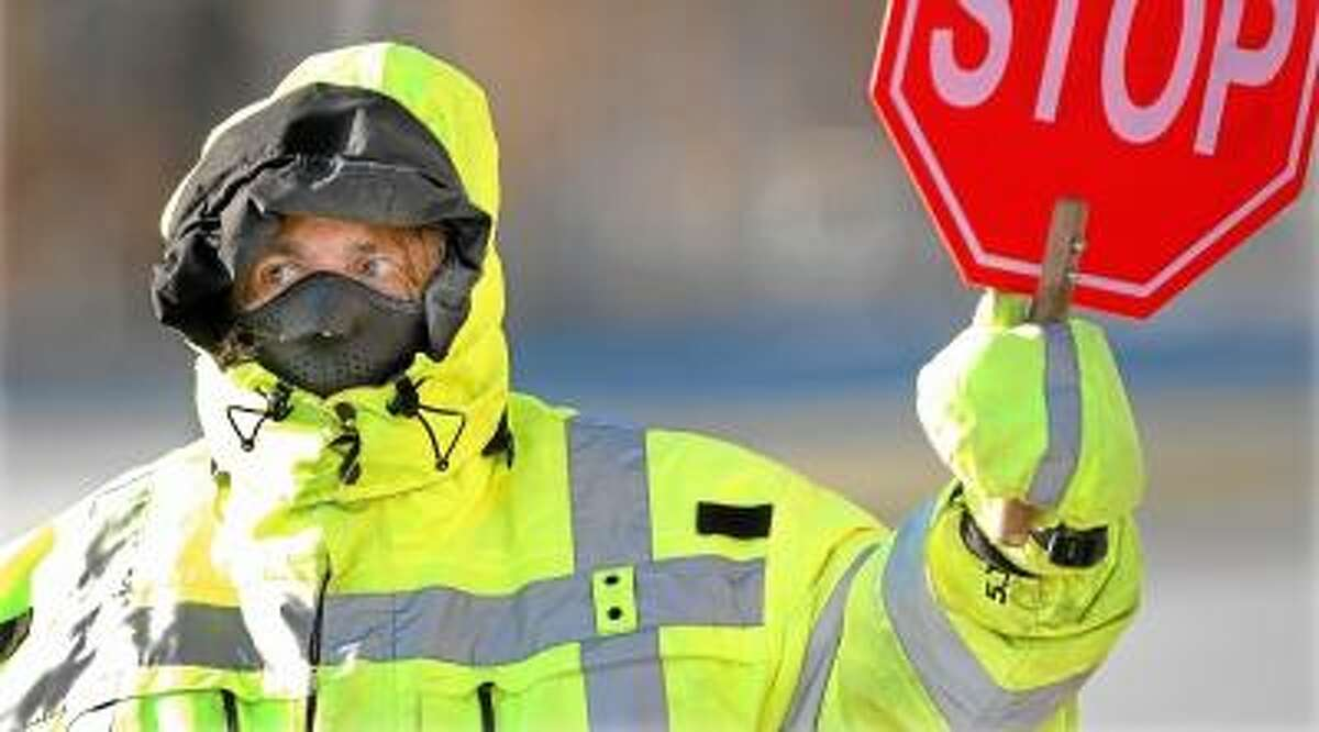 Catherine Avalone/The Middletown Press Veteran crossing guard Maria A. Payne, of New Britain, stands at the corner of St. John's Square and Main Street in Middletown every day from 7:20-9:15 a.m. and 1:30-3:45 p.m.
