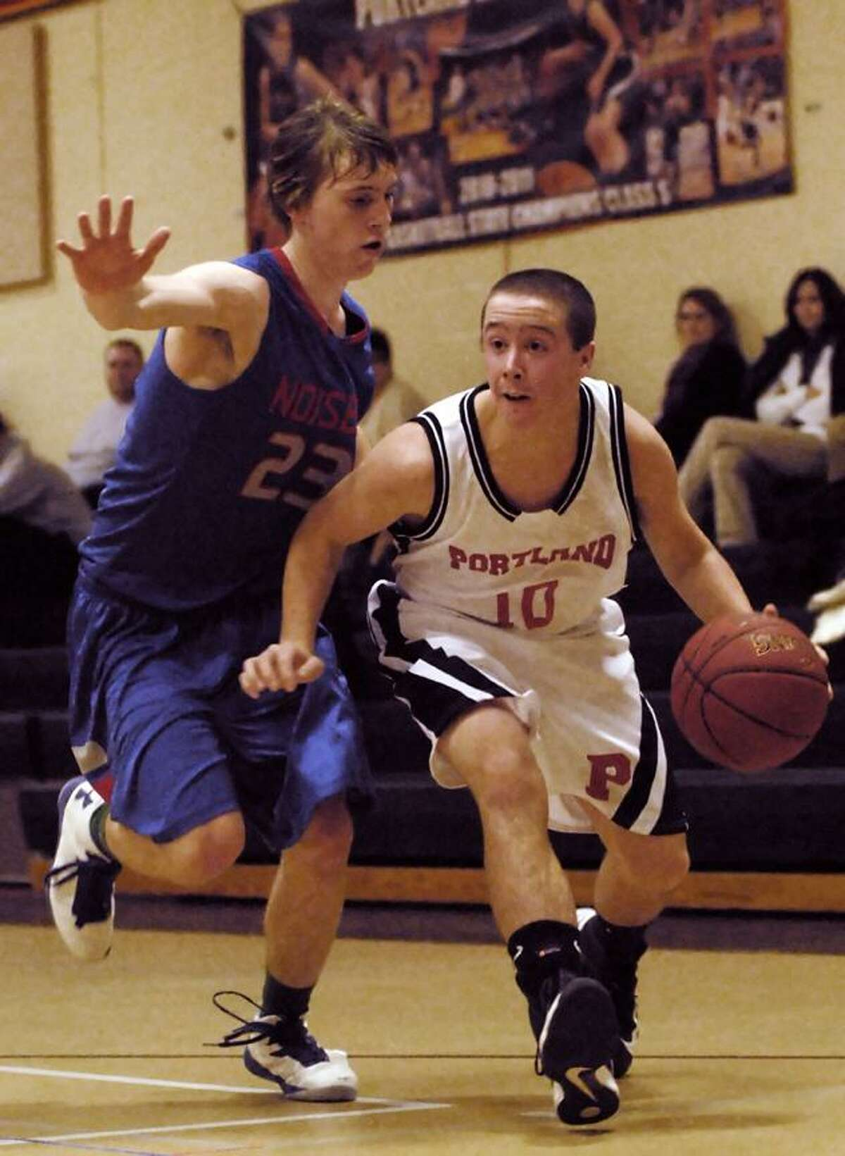 Catherine Avalone/The Middletown Press Portland's Cole Ogorzalek drives to the paint as Hale-Ray's Jason Traceski defends Tuesday afternoon in Portland.