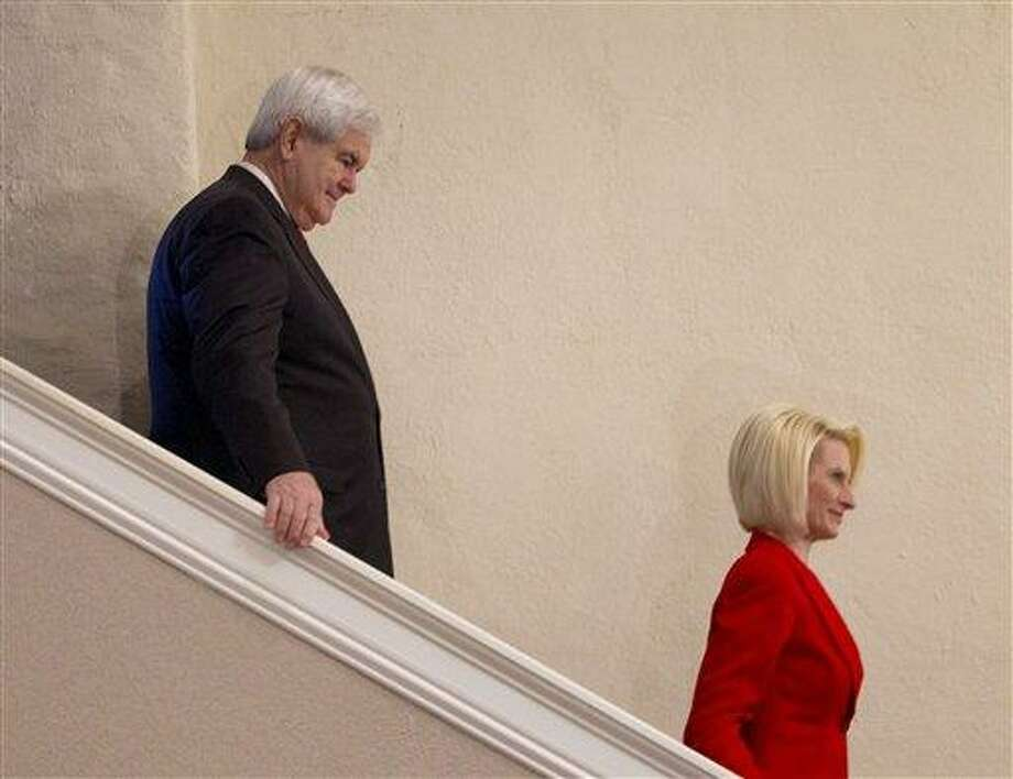 Republican presidential candidate and former House Speaker Newt Gingrich follows current wife, Callista, as they arrive Wednesday at the Christ Central Community Center in Winnsboro, S.C. Associated Press Photo: AP / AP