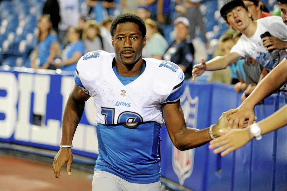 Detroit Lions wide receiver Nate Burleson broke his arm in a one-car accident early Tuesday morning while driving home after watching the Broncos-Raiders Monday Night Football game. Photo: Gary Wiepert — The Associated Press  / FR170498 AP