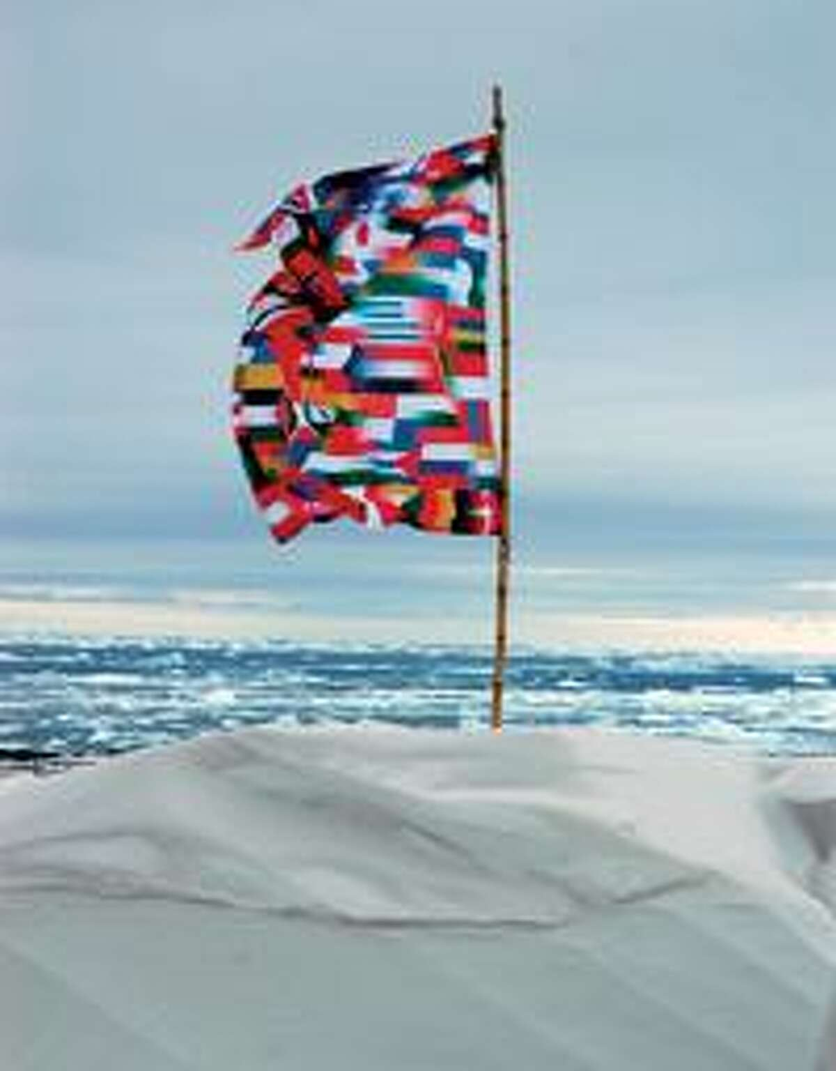 Lucy+Jorge Orta, Antarctic Village--No Borders, Metisse Flag, 2007, Installation on the Antarctic Peninsula, inkjet on polymide, eyelets, 39.5 x 59 inches, edition of 7 (photo: Thierry Bal)