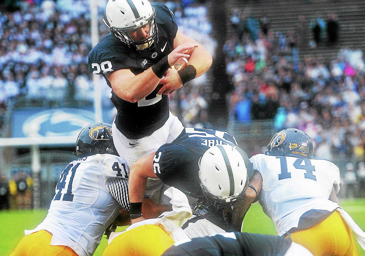 Penn State running back Zach Zwinak leaps over the Kent State defense to score his second touchdown during the Nittany Lions' 34-0 victory Saturday at State College, Pa.