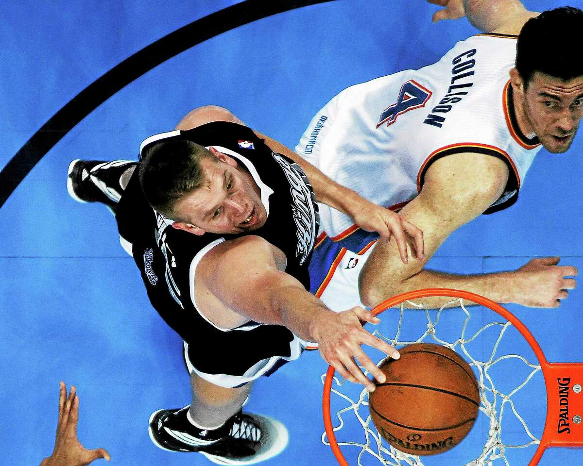 Center Cole Aldrich dunks in front of Oklahoma City Thunder forward Nick Collison during a April 15 game in Oklahoma City. Aldrich signed with the Knicks on Tuesday.