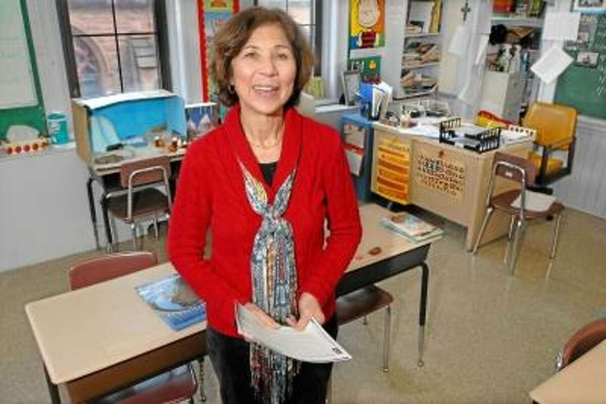 Catherine Avalone/The Middletown Press Rosemary D. Lauria, a fifth grade teacher at St. John School in Middletown has been awarded the Mohegan Tribe Challenge Grant for the 2013 spring semester to educate her students in the history, tradition, culture and government of Connecticut's Native American tribes. Lauria developed a curriculum involving the social, cultural and educational aspects of Connecticut's Mohegan Tribe.