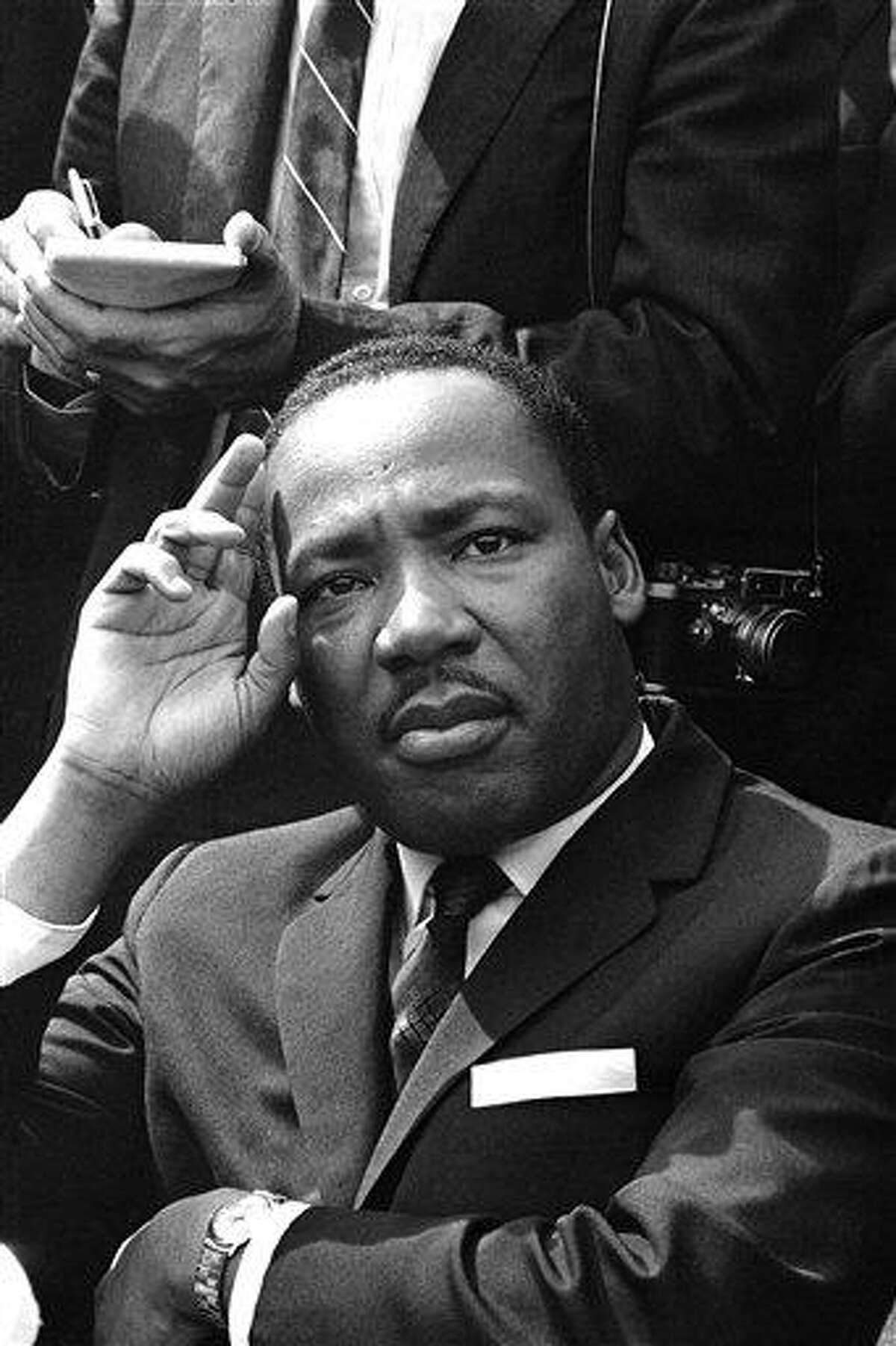 FILE - In this Sept. 16, 1963 file photo, Dr. Martin Luther King Jr. gives a news conference in Birmingham, Ala., announcing he and other African-American leaders have called for federal Army occupation of Birmingham in the wake of the previous day's church bombing and shootings which left six black people dead. (AP Photo/File)