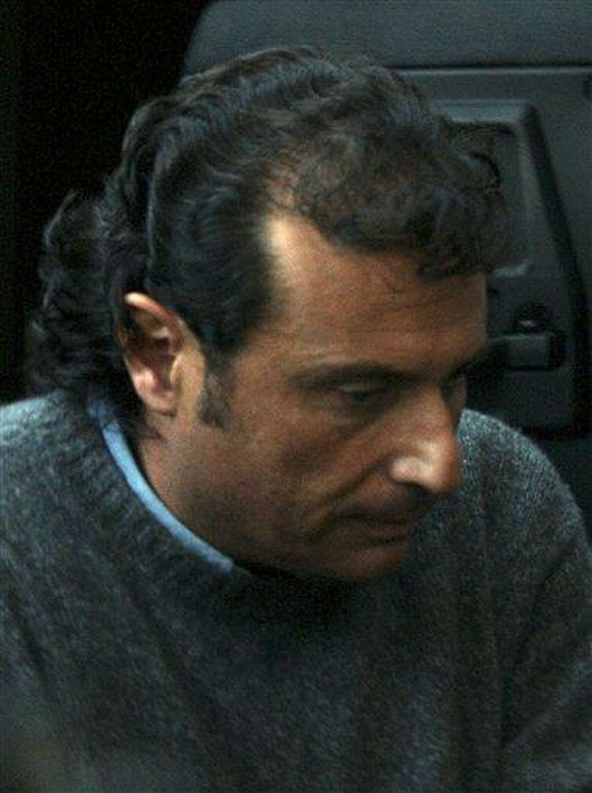 In this file photo from Tuesday, Francesco Schettino, captain of the Costa Concordia cruise ship that run aground off the tiny Island of Giglio last Friday, leaves the Grosseto court in Italy. Seamen have expressed almost universal outrage at Schettino, accused of manslaughter, causing a shipwreck and of abandoning his crippled cruise ship off Tuscany while passengers were still on board. Associated Press