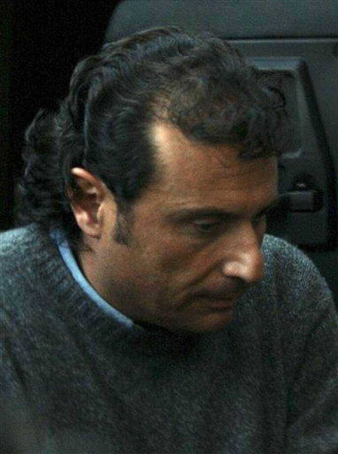 In this file photo from Tuesday, Francesco Schettino,  captain of the Costa Concordia cruise ship that run aground off the tiny Island of Giglio last Friday, leaves the Grosseto court in Italy. Seamen have expressed almost universal outrage at Schettino, accused of manslaughter, causing a shipwreck and of abandoning his crippled cruise ship off Tuscany while passengers were still on board.  Associated Press Photo: AP / PRESL