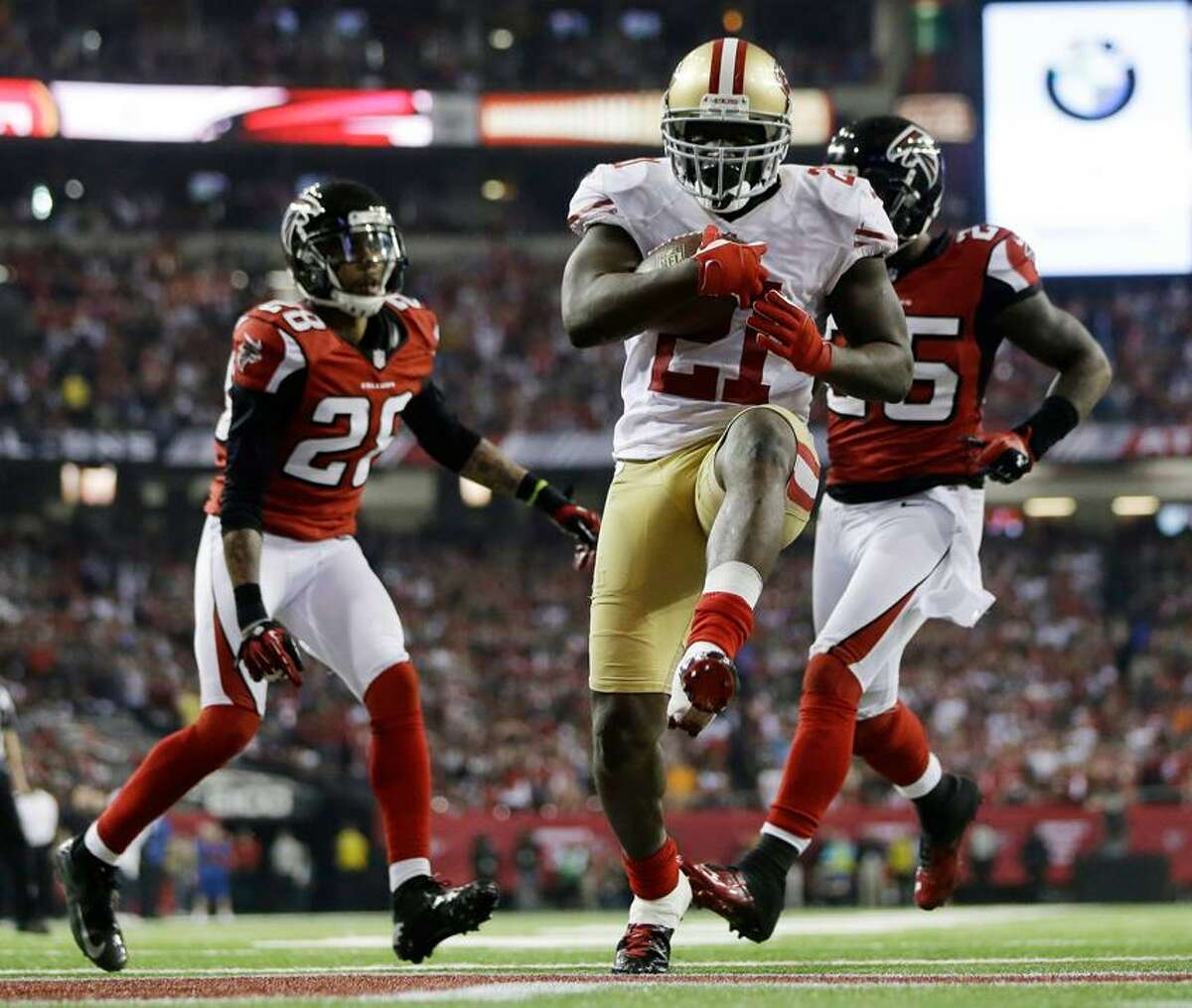 San Francisco 49ers' Frank Gore (21) breaks away for a nine-yard touchdown run during the second half of the NFL football NFC Championship game against the San Francisco 49ers Sunday, Jan. 20, 2013, in Atlanta. (AP Photo/David Goldman)