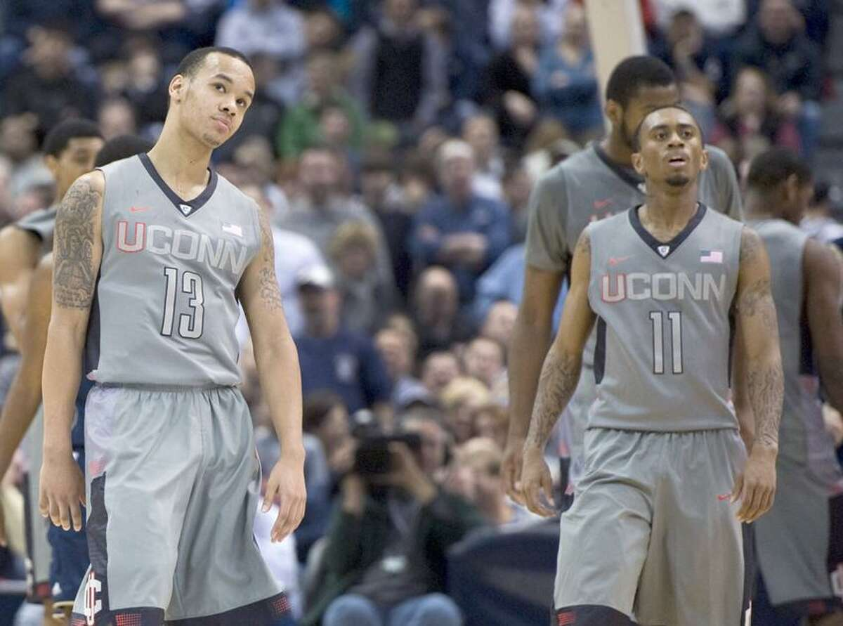 Connecticut's Shabazz Napier (13) and Ryan Boatright (11) react after a foul in the second half of an NCAA college basketball game against Notre Dame in Hartford, Conn., Sunday, Jan. 29, 2012. Notre Dame won 50-48. (AP Photo/Jessica Hill)