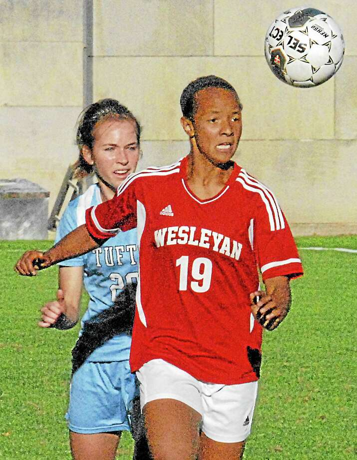 Wesleyan's Sarah Sylla battles Tuft's Blair Brady at Tuesday afternoon in Middletown. Tufts defeated the Cardinals 1-0 in overtime. Photo: Jimmy Zanor — The Middletown Press