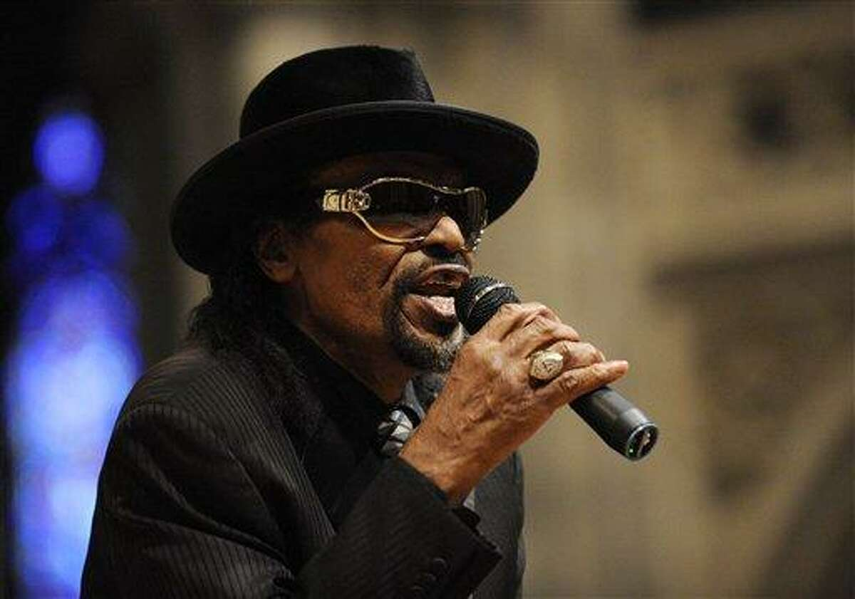 In this January 2010 file photo, master of ceremonies Chuck Brown speaks during a program to celebrate the legacy of the late Martin Luther King, Jr. at the Washington National Cathedral in Washington. Brown, who styled a unique brand of funk music as a singer, guitarist and songwriter known as the