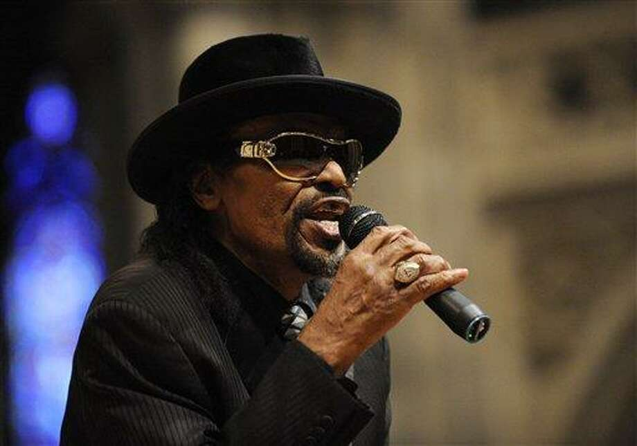 """In this January 2010 file photo, master of ceremonies Chuck Brown speaks during a program to celebrate the legacy of the late Martin Luther King, Jr. at the Washington National Cathedral in Washington. Brown, who styled a unique brand of funk music as a singer, guitarist and songwriter known as the """"godfather of go-go,"""" died Wednesday after suffering from pneumonia. He was 75. Associated Press Photo: ASSOCIATED PRESS / AP2010"""
