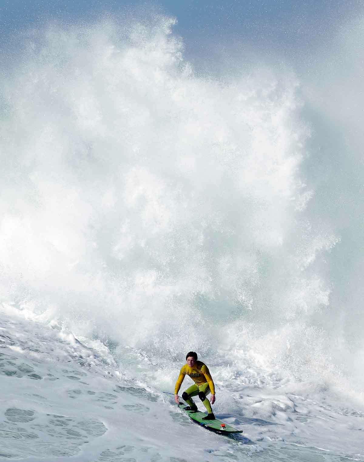 Colin Dwyer competes during heat 4 of the Mavericks Invitational big wave surf contest in Half Moon Bay, Calif., Sunday, Jan. 20, 2013. (AP Photo/Marcio Jose Sanchez)