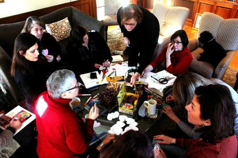 """Members decorate hearts to post online for the """"How Do You Wear Your Heart?"""" national action during the first meeting of the One Million Moms for Gun Control Central Conn.Kathleen Schassler/West Hartford News"""