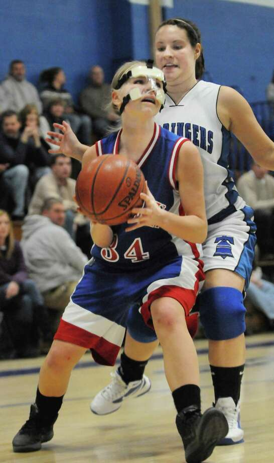 The Middletown Press 1.5.12    East Hampton's Ashley Chasse drives past Hale-Ray's Lydia Walter Thursday night. East Hampton defeated the Noises 43-34 at home. / TheMiddletownPress