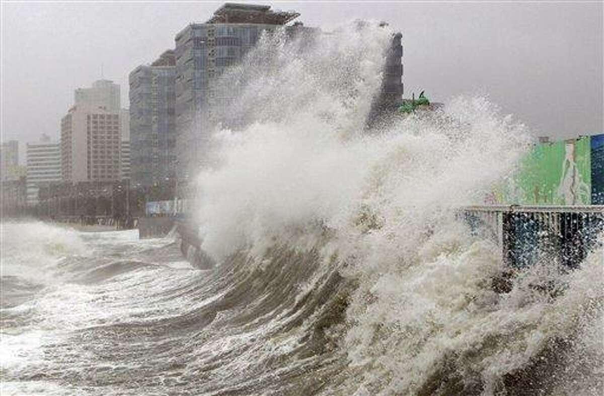 High waves caused by Typhoon Sanba crash on Haeundae beach Monday in Busan, south of Seoul, South Korea. Associated Press