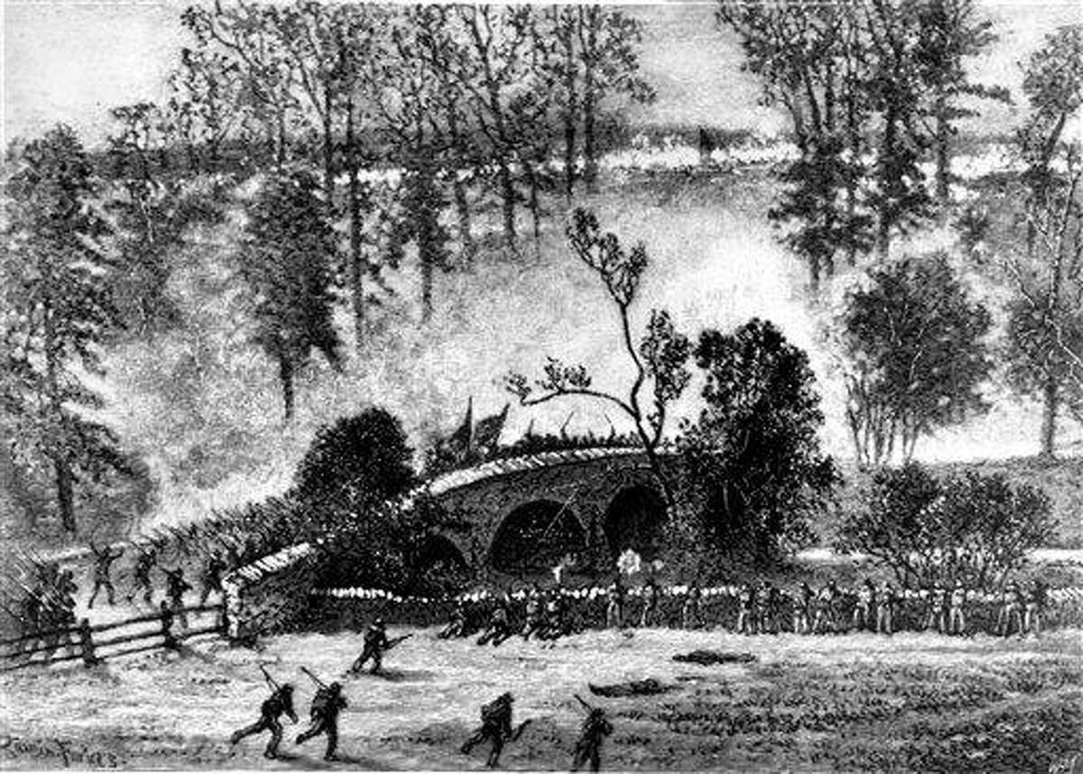 FILE -- An undated file photo shows an engraving sketch depicting Union troops charging across the Burnside bridge over Antietam Creek in the third and final day of the Battle of Antietam near Sharpsburg, Md., on Sept. 17, 1862. The Battle of Antietam was so big, they're re-enacting it twice. And nearly 8,000 re-enactors had to make a choice: strictly regimented realism or bombastic spectacle? The two privately financed events, both open to the public, were scheduled on back-to-back weekends leading up to Monday's 150th anniversary of the bloodiest day of combat on U.S. soil. (AP Photo/file)