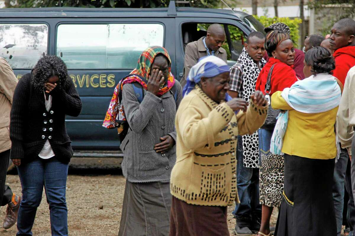 """Family members, react, outside the Nairobi City Mortuary in Nairobi mourn the death of loved ones killed in the Westgate attack in Nairobi, Kenya Tuesday, Sept. 24, 2013. Islamic militants who staged a deadly attack on a Kenya mall said Tuesday hostages are still alive and fighters are """"still holding their ground,"""" as Nairobi's city morgue prepared for the arrival of a large number of bodies of people killed, an official said. (AP Photo/Khalil Senosi)"""