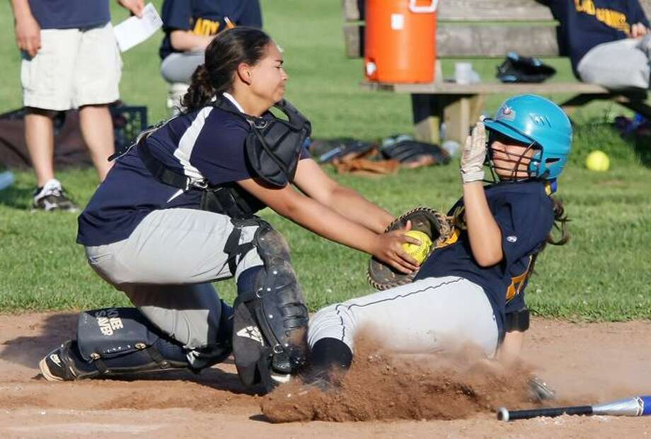Special to the Press  05.17.12. Vinal Tech's Karen Agogliati hammers a first-inning home run in Thursday's softball game against Hillhouse. Hillhouse won, 25-6. To buy a glossy print of this photo and more, visit www.middletownpress.com / a