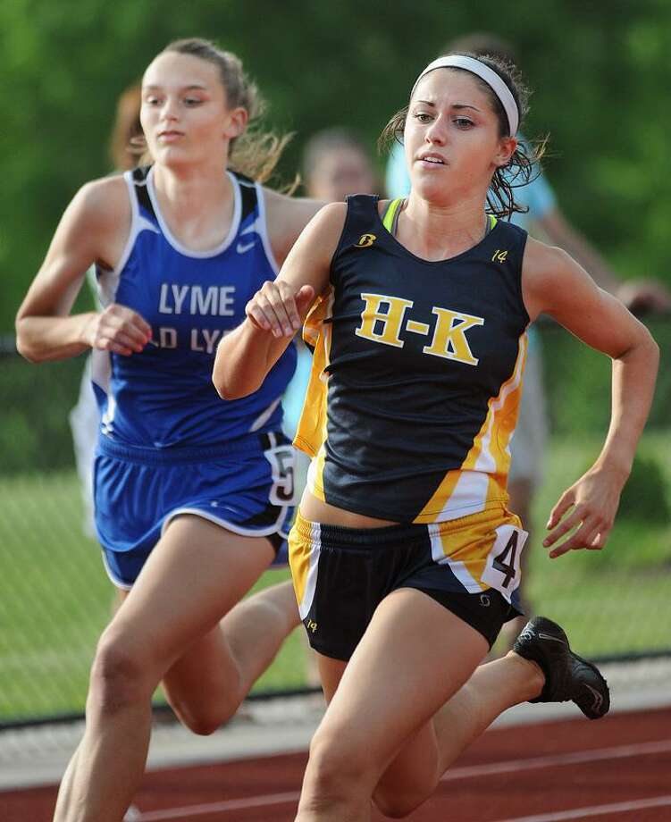 Catherine Avalone/The Middletown PressHaddam-Killingworth junior Leah Pfrommer competes in the 200m and broke the Shoreline Conference Outdoor Track & Field meet record Wednesday afternoon. Pfrommer also competed and won the 100m, long jump and triple jump, winning the same four events last year. / TheMiddletownPress