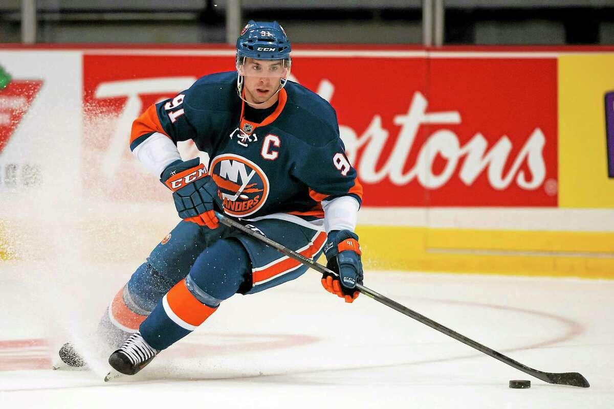 New York Islanders forward John Tavares moves the puck against the Calgary Flames during a preseason game on Sept. 17 in Regina, Saskatchewan.