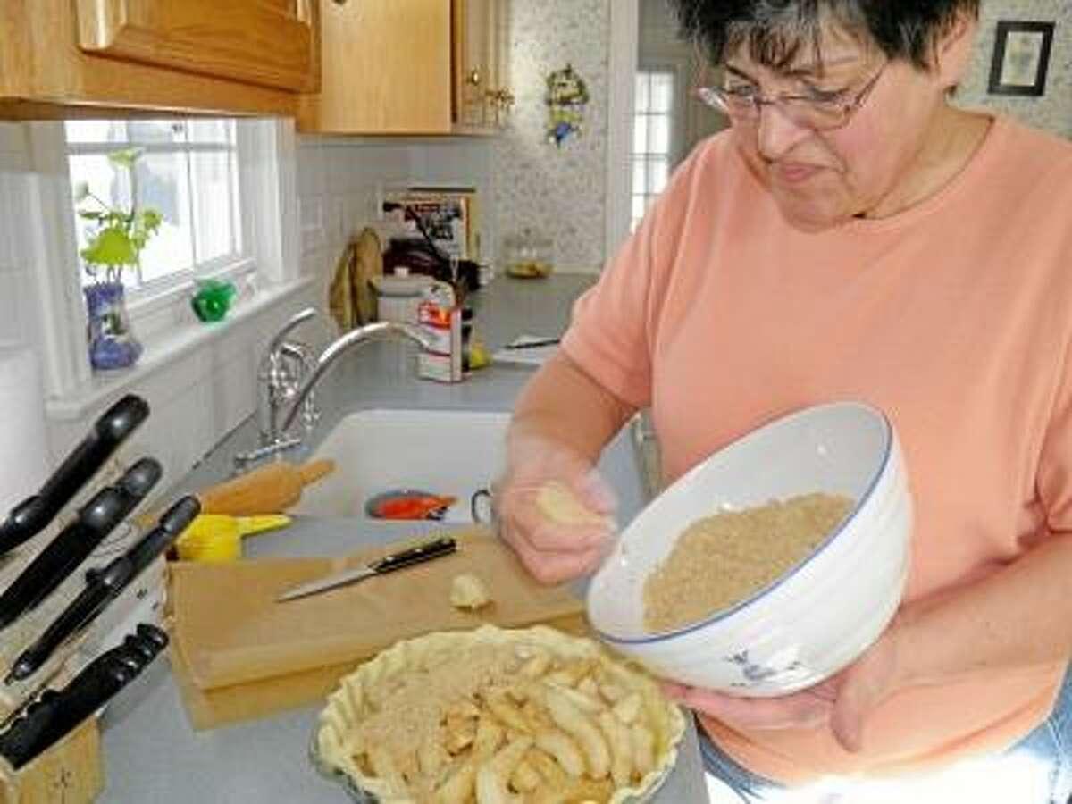 Marilyn assembling the pie.