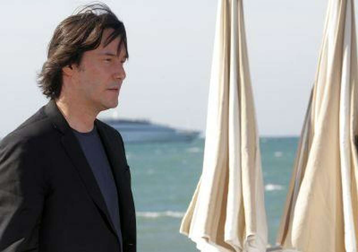 Actor and director Keanu Reeves poses during a photocall on a front pier to present his film