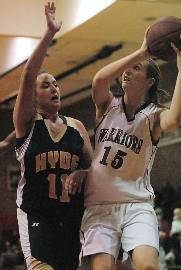 Catherine Avalone/The Middletown PressValley Regional's Kiernan Decker eyes the hoop as Hyde's Sarah Kelley defends Monday afternoon in Deep River. The Warriors defeated the visitors from Hamden, 51-47 in overtime, 42-42 at the end of regulation.