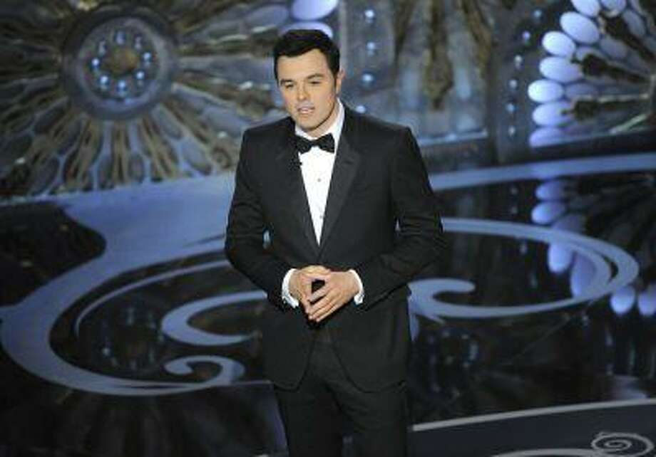 FILE - In this Feb. 24, 2013 file photo, host Seth MacFarlane speaks onstage during the Oscars at the Dolby Theatre in Los Angeles. MacFarlane is too busy to host the Oscars in 2014. He announced the news on Twitter Monday, May 20, 2013. (Photo by Chris Pizzello/Invision/AP, File) Photo: Chris Pizzello/Invision/AP / Invision