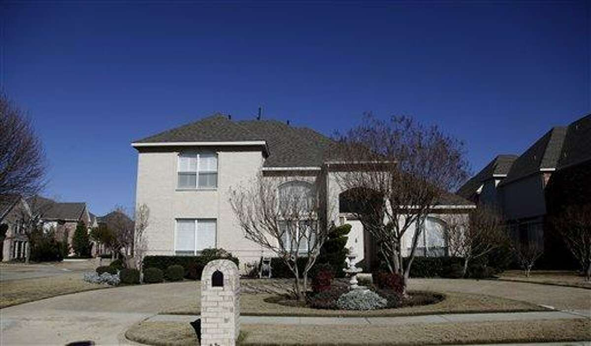 This, Jan. 12, 2012, photo shows the home where Moeed Abdul Salam, 37, spent formative years with his parents in the Dallas suburb of Plano, Texas. The family, originally from Pakistan, immigrated to the U.S. decades ago. Salam's father was a pilot for a Saudi airline and the family obtained American citizenship in 1986. Moeed Abdul Salam rejected his relatives' moderate faith and comfortable life, choosing instead a path that led him to work for al-Qaida. His odyssey ended late last year in a middle-of-the-night explosion in Pakistan after a paramilitary raid on his apartment. Associated Press