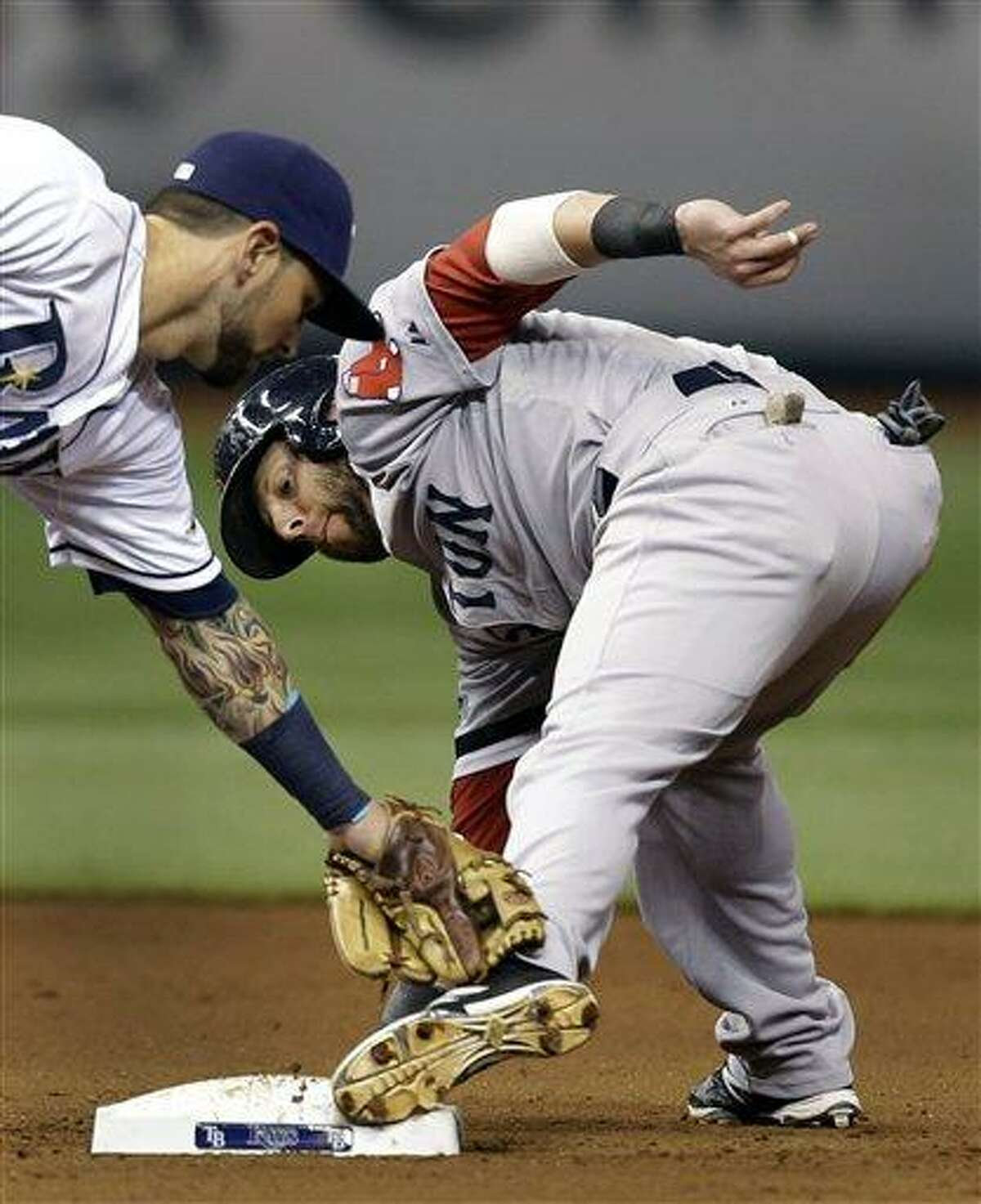 Boston Red Sox's Dustin Pedroia, right, gets into second with a stolen base ahead of the tag by Tampa Bay Rays second baseman Ryan Roberts during the sixth inning of a baseball game, Monday, Sept. 17, 2012, in St. Petersburg, Fla. (AP Photo/Chris O'Meara)