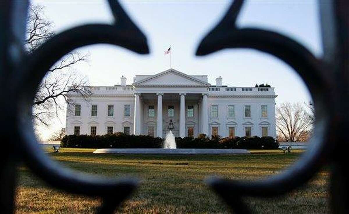 The North Lawn of the White House is seen Wednesday in Washington. As hundreds of Occupy protesters massed outside the gates of the White House, an apparent smoke bomb was thrown over the fence Tuesday night, forcing authorities to disperse the crowds. Associated Press