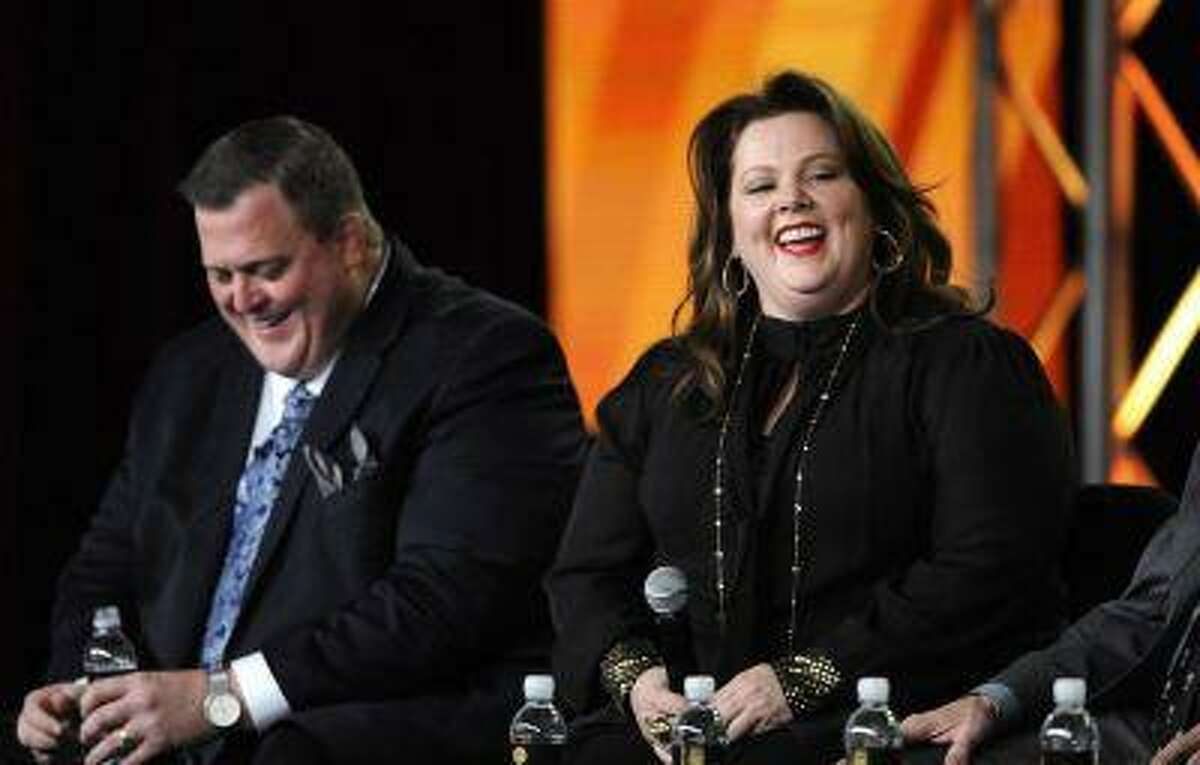 Cast members Billy Gardell (L) and Melissa McCarthy participate in a panel for CBS series