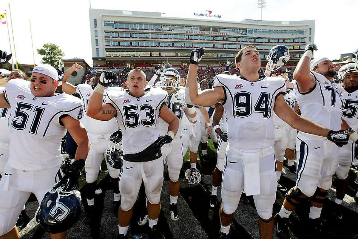 Members of the Connecticut football team acknowledge fans in the stands after an NCAA college football game against Maryland in College Park, Md., Saturday, Sept. 15, 2012. Connecticut won 24-21. (AP Photo/Patrick Semansky)