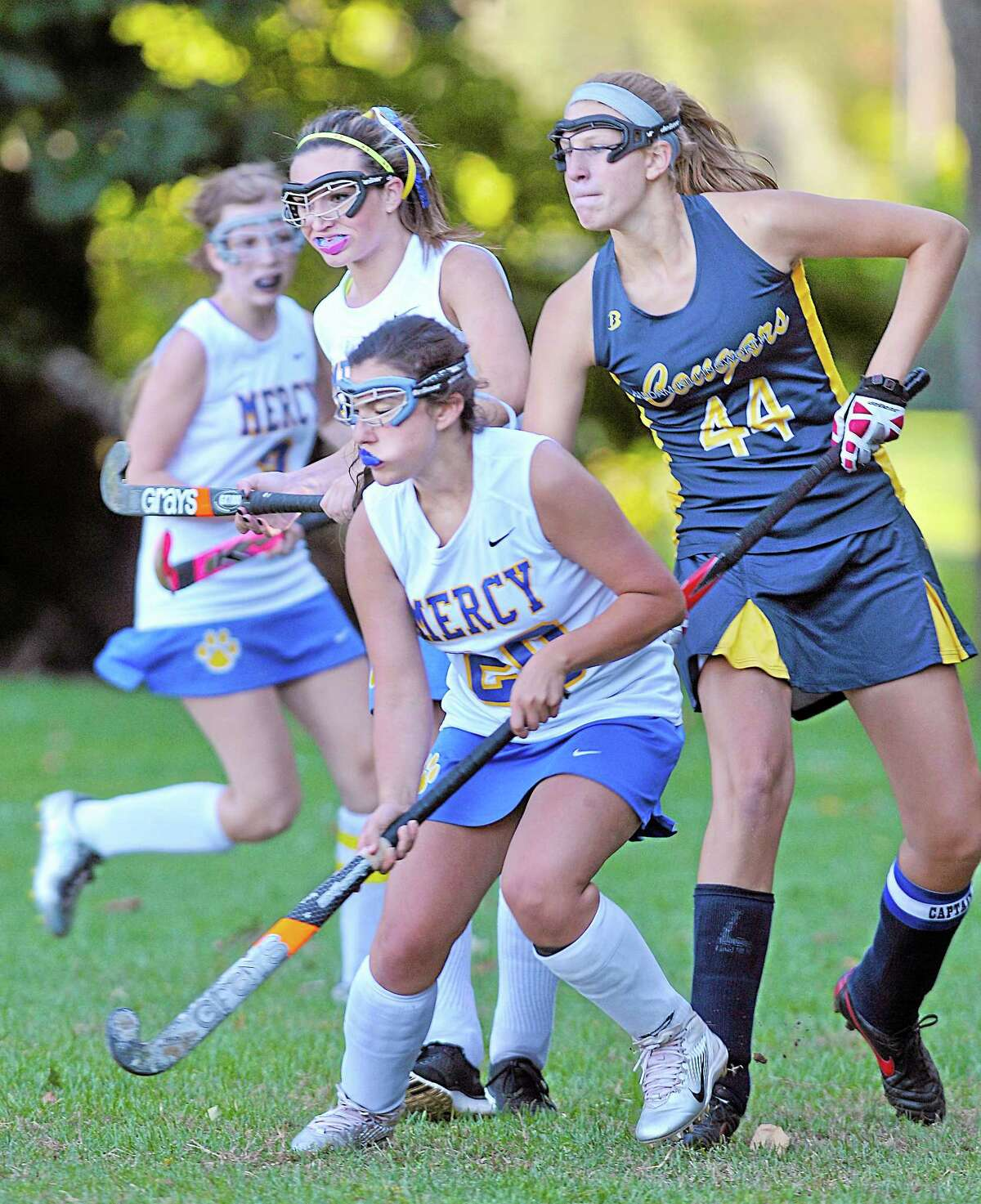 Mercy's Christine Hedburg (#20) and Juliana DellaCamera double team Haddam-Killingworth senior Kiley Anderson in the second half Monday afternoon in Middletown. H-K defeated the Tigers 2-0.